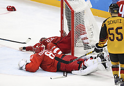 PYEONGCHANG, Feb. 25, 2018  Vasili Koshechkin (Front) of Olympic athletes from Russia vies for the puck during men's ice hockey final against Germany at Gangneung Hockey Centre, in Gangneung, South Korea, Feb. 25, 2018. The Olympic Athletes from Russia team defeated Germany 4:3 and won the gold medal. (Credit Image: © Han Yan/Xinhua via ZUMA Wire)