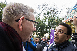 London, UK. 16 November, 2019. Len McCluskey, General Secretary of Unite, discusses freedom of movement with an activist from Movement for Justice as he arrives at Labour's Clause V meeting. The Clause V meeting, chaired by the party leader and attended by members of the National Executive Committee (NEC), relevant Shadow Cabinet members and members of the National Policy Forum, will finalise the party's general election manifesto. The meeting is named after Clause V of the Labour Party rulebook.