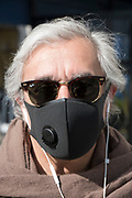 """April, 16th 2020 - Paris, Ile-de-France, France: Parisians wearing a range of masks and facial coverings in the hope of protecting themselves from the spread of the Coronavirus, during the second month of near total lockdown imposed in France. A week after President of France, Emmanuel Macron, said the citizens must stay at home for at least 15 days, that has been extended. He said """"We are at war, a public health war, certainly but we are at war, against an invisible and elusive enemy"""". All journeys outside the home unless justified for essential professional or health reasons are outlawed. Anyone flouting the new regulations is fined. Nigel Dickinson"""