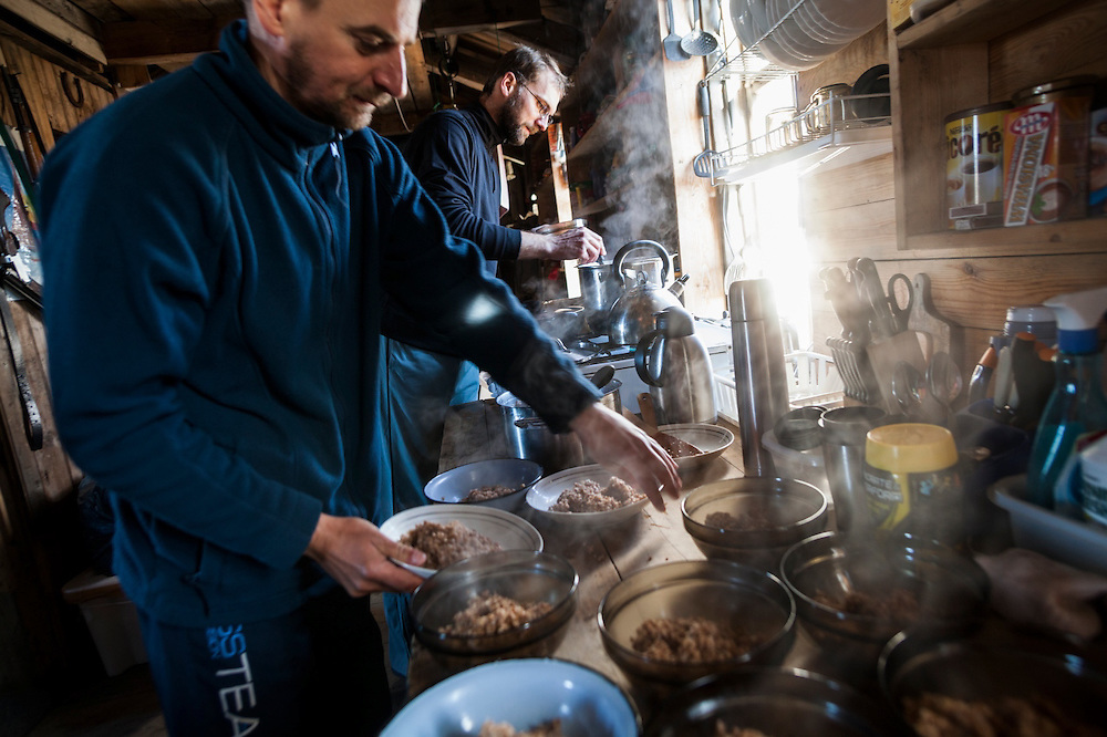 Men prepare breakfast for the rest of the crew at the Polish field station in Calypsobyen, Svalbard.