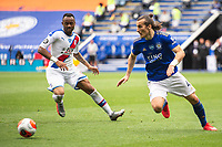 LEICESTER, ENGLAND - JULY 04: Caglar Soyuncu of Leicester City looks to clear the ball from Jordan Ayew of Crystal Palace during the Premier League match between Leicester City and Crystal Palace at The King Power Stadium on July 4, 2020 in Leicester, United Kingdom. Football Stadiums around Europe remain empty due to the Coronavirus Pandemic as Government social distancing laws prohibit fans inside venues resulting in all fixtures being played behind closed doors. (Photo by MB Media)