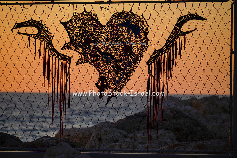 Silhouette of a fence on the beach at sunset. Photographed on the Tel Aviv Beach, Israel in March