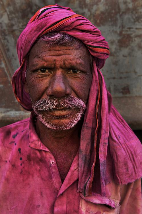 Rickshaw driver caught up in Holi, Bodh Gaya, Bihar, India