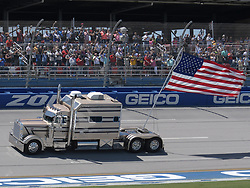 April 29, 2018 - Talladega, AL, U.S. - TALLADEGA, AL - APRIL 29: The American Flag is driven through the tri-oval before the Monster Energy Cup Series 49th Annual Geico 500 on April 29, 2018, at Talladega Superspeedway in Talladega, AL. (Photo by Jeffrey Vest/Icon Sportswire) (Credit Image: © Jeffrey Vest/Icon SMI via ZUMA Press)