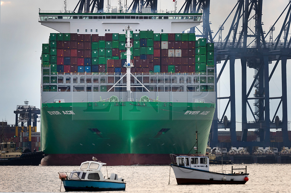 DATE CORRECTION © Licensed to London News Pictures. 12/09/2021. Felixstowe, UK. The world's largest container ship the Ever Ace is turned around by tugs as she arrives at the Port of Felixstowe on her maiden voyage. The 400m long ship can hold 23,992 containers, beating the previous record holder HMM Algeciras by 28. The Port of Felixstowe is the largest container port in the United Kingdom. Photo credit: Peter Macdiarmid/LNP