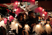 Holiday shoppers are framed by lights at the holiday market in Unin Square.