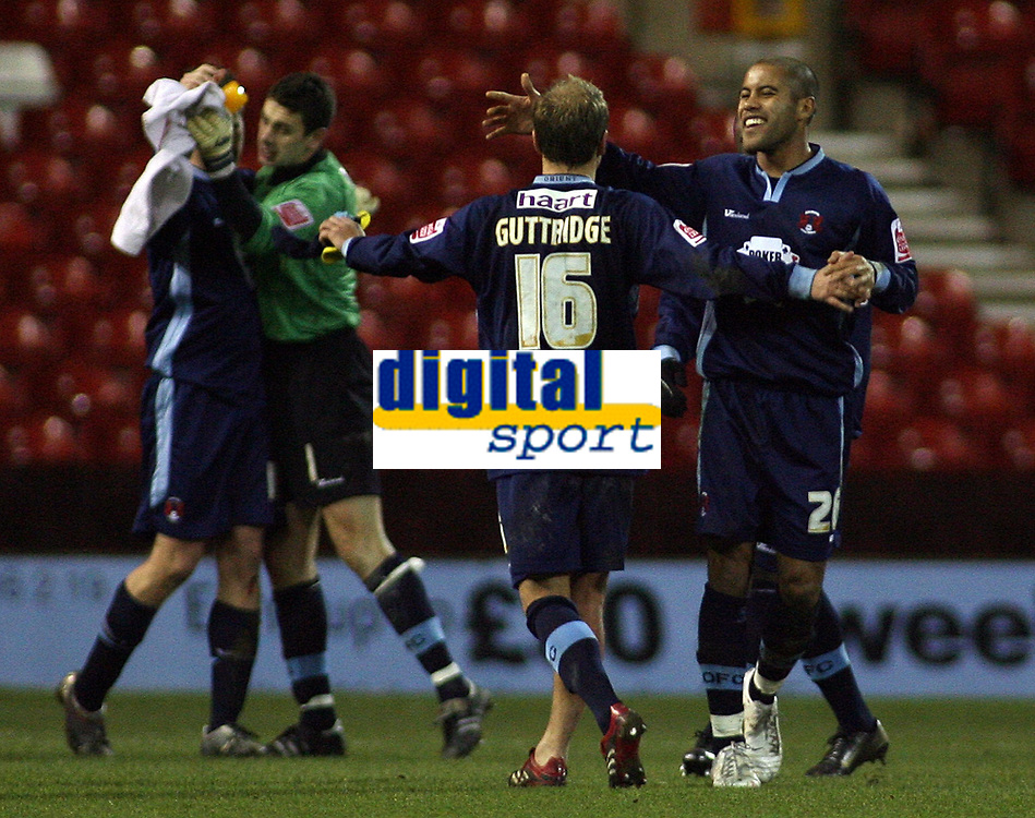 Photo: Paul Thomas.<br /> Nottingham Forest v Leyton Orient. Coca Cola League 1. 16/12/2006.<br /> <br /> Orient's Luke Guttridge (16) and Adam Chambers celebrate the win.