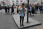 Stylish Chinese man texting at Piccadilly Circus during Chinese New Year celebrations in central London, United Kingdom. Tens of thousands of people gathered in the West End filling the streets and joining in with the festival atmosphere. (photo by Mike Kemp/In Pictures via Getty Images)