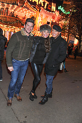 Left to right, PHIL TURNER, LIZZIE CUNDY and GARY COCKERILL at the opening of the 2012 Winter Wonderland, Hyde Park on 22nd November 2012.