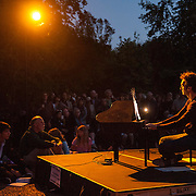 Yegor Shevtsov performs works by Erik Satie and John Cage on toy piano at Libbey Park Playground on June 7, 2013 in Ojai, California.