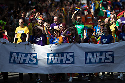 © Licensed to London News Pictures . 24/08/2019. Manchester, UK. NHS float . The 2019 Manchester Gay Pride parade through the city centre , with a Space and Science Fiction theme . Manchester's Gay Pride festival , which is the largest of its type in Europe , celebrates LGBTQ+ life . Photo credit: Joel Goodman/LNP