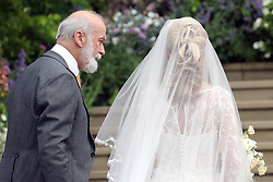 Lady Gabriella Windsor walks into the chapel with her father Prince Michael of Kent for her wedding to Thomas Kingston at St George's Chapel in Windsor Castle.