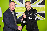 Match sponsor Grundon present Forest Green Rovers Joseph Mills(23) with the man of the match award during the The FA Cup 1st round replay match between Forest Green Rovers and Oxford United at the New Lawn, Forest Green, United Kingdom on 20 November 2018.