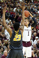 Texas A&M's D.J. Hogg (1) takes a three point shot over Missouri's Jakeenan Gant (23) during an NCAA college basketball game, Saturday, Jan. 23, 2016, in College Station, Texas.  (AP Photo/Sam Craft)