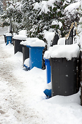 The A6135 Ecclesfield Rd, Chapeltown Sheffield. Covered by one nights snowfall, bins are left un-emptied as refuse collectors fail to make their rounds during the most widespread Snows to hit Britain for 20 years.1st December 2010.Images © Paul David Drabble