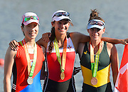 Sydney, Australia.  left to Right Bronze medalist, KOR LW1X. Jin JI YOO middle  Gold medalist, CAN LW1X. Jaclyn HALCO,  right. Silver medalist Sarah POUND, Women's Lightweight Single Scull  medalist. FISA World Cup I. and  Sydney International Rowing Regatta. Sydney International Rowing Centre, Penrith Lakes, NSW.   Saturday   23/03/2013 [Mandatory Credit. Peter Spurrier/Intersport Images]..