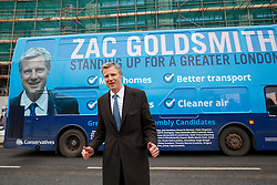 © Licensed to London News Pictures. 15/03/2016. London, UK. Conservative candidate for Mayor of London Zac Goldsmith posing with his campaign bus after visiting the construction site of Barnet & Southgate College's new campus to unveil his new housing pledges as part of his action plan for Greater London. Photo credit: Tolga Akmen/LNP