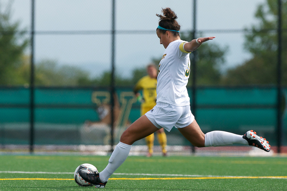 Vermont midfielder Alexa DeMaio (5) kicks the ball during the women's soccer game between the Brown Bears and the Vermont Catamounts at Virtue Field on Saturday afternoon September 8, 2012 in Burlington, Vermont.