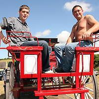 Gerard Farrell and Thomas Corcoran soaking up the sun rays at the annual Spancilhill Horse Fair on Tuesday.<br /> Photograph by Yvonne Vaughan