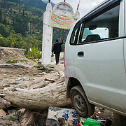 """A car is jumbled amongst other detritus from the """"Himayan Tsunami"""" that took out several towns - including Derali - and killed thousands on June 16, 2013."""