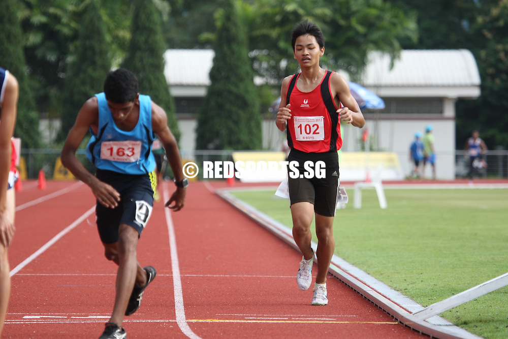 Choa Chu Kang Stadium, Monday, April 8, 2013 — Leroi Lee of Nan Hua High led from start to finish to win the B Division 3,000m gold at the 54th National Schools Track and Field Championships.<br /> <br /> Story: http://www.redsports.sg/2013/04/13/b-div-3000m-leroi-lee-nan-hua-high/