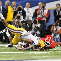 Dec 3, 2011; Atlanta, GA, USA; LSU Tigers quarterback Jordan Jefferson (9) is tackled by Georgia Bulldogs linebacker Cornelius Washington (83) during the second half of the 2011 SEC championship game at the Georgia Dome.  Mandatory Credit: Derick E. Hingle-US PRESSWIRE