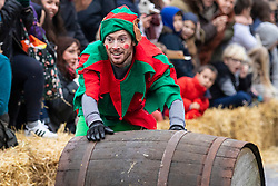 © Licensed to London News Pictures. 26/12/2018. Grantchester, UK. The annual Boxing Day barrel rolling relay race in Grantchester, Cambridgeshire. Four teams from local pubs compete to roll the empty barrels as rapidly as possible up and down the main road with the fastest time winning. Photo credit: Rob Pinney/LNP