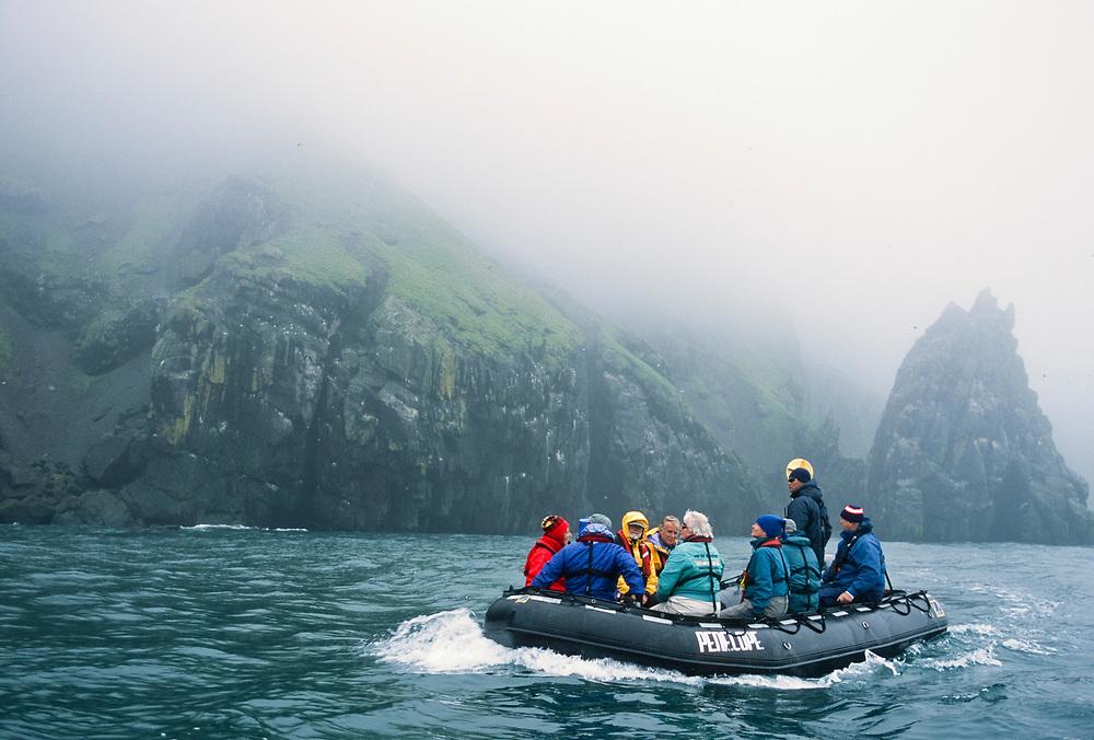Alaska. Alaska Maritime National Wildlife Refuge, Bering Sea, Hall Island, boating past nesting seabirds.