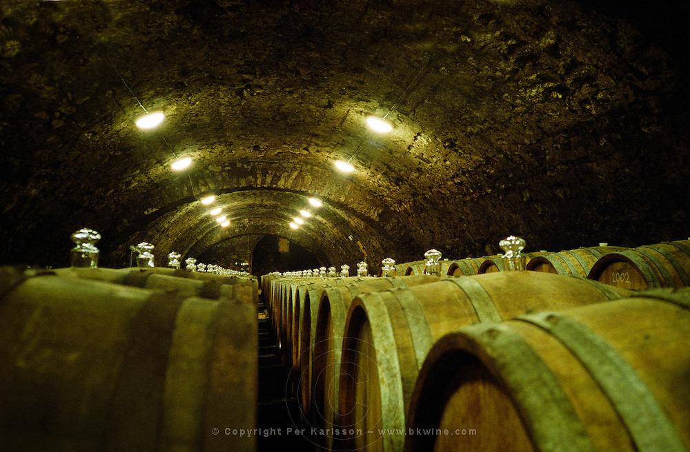 "The Kiralyudvar winery in Tarcal, Tokaj: An underground cellar tunnel with barrels of aging Tokaj wine. Kiralyudvar (meaning ""King's Court"")is run by Istvan Szepsy, considered maybe the best winemaker in Tokaj. he also makes Tokaj under his own name.  Credit Per Karlsson BKWine.com"
