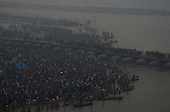 Millions of Indian Hindu devotees walk across a pontoon bridge