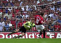 Photo: Richard Lane.<br />Arsenal v Manchester United. The FA Charity Shield 2003. 10/08/2003.<br />Ole Gunnar Solskjær slots a penalty past Jens Lehmann.