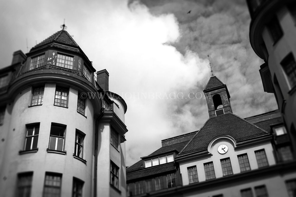 Black and white photo of a rooftop of a building in Stockholm, Sweden.