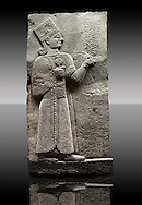 Picture & image of a Neo-Hittite orthostat showing a releif sculpture  of the Goddess Kubaba from Karkamis,, Turkey.  In her right hand she is holding a pomegranate. An Ankara Museum of Anatolian Civilizations exhibit.