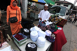 """June 15, 2018 - Philippines - A """"tutob"""" selling outside the Golden Mosque during the celebration of Eidul Fitr in Manila City on June 15, 2015. Eidul Fitr is an important celebration for Filipino Muslims, marking the end of the month-long fast during Ramadan. In 2018, Eidul Fitr falls on Friday 15 June. (Credit Image: © Gregorio B. Dantes Jr/Pacific Press via ZUMA Wire)"""
