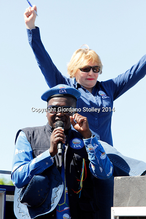 DURBAN - 5 April 2014 - The leader of the Democratic Alliance Helen Zille sits atop a container in Durban's Welbedacht area of Chatsworth as the party's provincial leader Sizwe Mchunu addresses members of an informal settlement which the Democratic Alliance had  claimed was not being provided with services by the eThekwini Metro Municipality. The country is set to go to the polls on May 7. Picture: Allied Picture Pres/APP