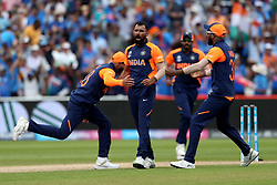 India's Mohammed Shami celebrates the wicket of England's Eoin Morgan, caught by Kedar Jadhav, during the ICC Cricket World Cup group stage match at Edgbaston, Birmingham.