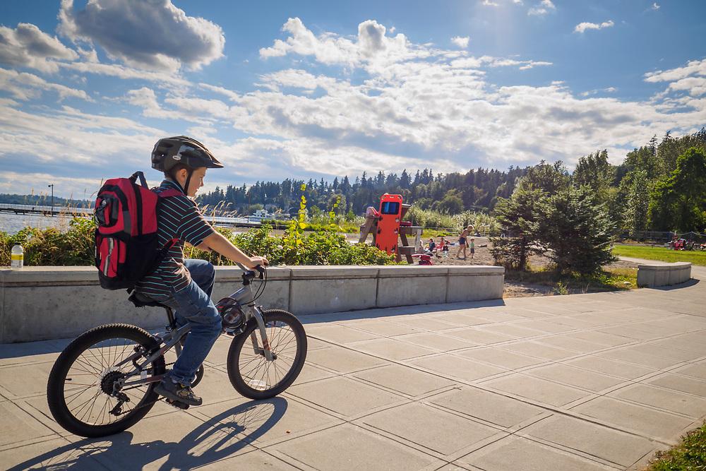 United States, Washington, Kirkland, boy on bicycle at Juanita Beach Park
