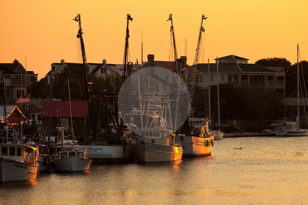 Sunset over Shem Creek shrimp boats in Mount Pleasant, SC