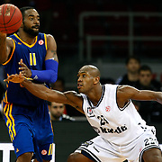 Besiktas's Patrick Christopher (L) and BC Khimki MR's Kelvin Rivers (L) during their Turkish Airlines Euroleague Basketball Top 16 Game 1 match Besiktas between BC Khimki MR at Abdi ipekci Arena in Istanbul, Turkey, Thursday, December 27, 2012. Photo by TURKPIX