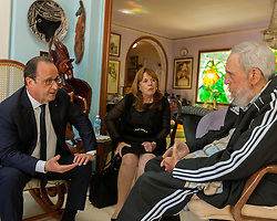 File photo : Handout picture of French President Francois Hollande speaking to Cuban historical leader Fidel Castro during a meeting in Havana, Cuba, on May 11, 2015. Hollande's Cuba trip, the first ever by a French leader, has highlighted the simultaneously cooperative and competitive relationship between the United States and the European Union as both look to increase business with Havana. Photo via ABACAPRESS.COM