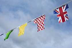 © Licensed to London News Pictures. 29/04/2016. Pateley Bridge, UK. Colourful flags line the streets of Knaresborough in North Yorkshire awaiting the passing of the 2016 Tour De Yorkshire. The three-day road cycling race held annually across Yorkshire is in it's second year. Photo credit : Ian Hinchliffe/LNP