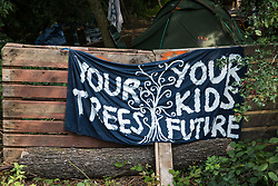 Denham, UK. 11th September, 2020. A banner reading 'Your Trees Your Kids Future' placed by environmental activists from HS2 Rebellion at Denham Protection Camp. Anti-HS2 activists continue to try to prevent or delay works on the controversial £106bn HS2 high-speed rail link from a series of such protection camps based along the route of the line between London and Birmingham.