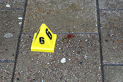 © Licensed to London News Pictures. 13/10/2019. London, UK. Evidence marker and blood stains outside West Green Halal Meat and Groceries store on West Green Road in Tottenham, North London where two men were stabbed and rushed to hospital shortly after 9.30am this morning. The ages of the two victim and their condition is not yet know. Photo credit: Dinendra Haria/LNP