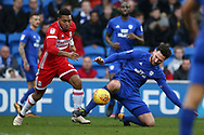 Sean Morrison of Cardiff city ® gets to the ball ahead of  Britt Assombalonga of Middlesbrough (9) .EFL Skybet championship match, Cardiff city v Middlesbrough at the Cardiff city Stadium in Cardiff, South Wales on Saturday 17th February 2018.<br /> pic by Andrew Orchard, Andrew Orchard sports photography.