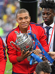 Paris Saint-Germain's French forward Kylian Mbappé celebrates with the trophy at the end of the French Cup final football match between Les Herbiers and Paris Saint-Germain (PSG), on May 8, 2018 at the Stade de France in Saint-Denis, outside Paris, France. Photo by Christian Liewig/ABACAPRESS.COM