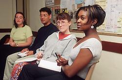 Multiracial group of social work students listening during seminar,
