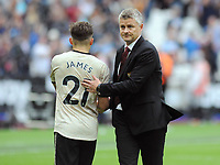 Football - 2019 / 2020 Premier League - West Ham United vs. Manchester United<br /> <br /> Manchester United Manager, Ole Gunnar Solskjer consoles Daniel James after the match after losing 2-0, at The London Stadium.<br /> <br /> COLORSPORT/ANDREW COWIE