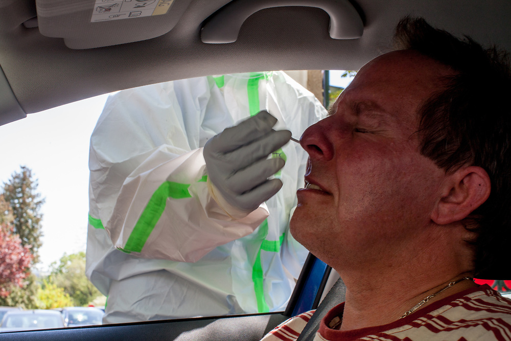 """Me tested for Covid-19. A drive in Covid-19 test station at the Vinohrady hospital in Prague. Everybody entering the Czech Republic from abroad needs to be for 14 days in quarantine or make a Covid-19 PCR test - if the test is """"negative"""" no quarantine is needed."""