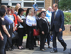 Former West Yorkshire and Merseyside chief constable Sir Norman Bettison (right) walks past friends and family of victims as he arrives at Warrington Magistrates' Court where he faces charges following an investigation into the Hillsborough disaster and its aftermath.
