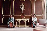 Two elderly men sitting in a Miami Beach hotel lobby